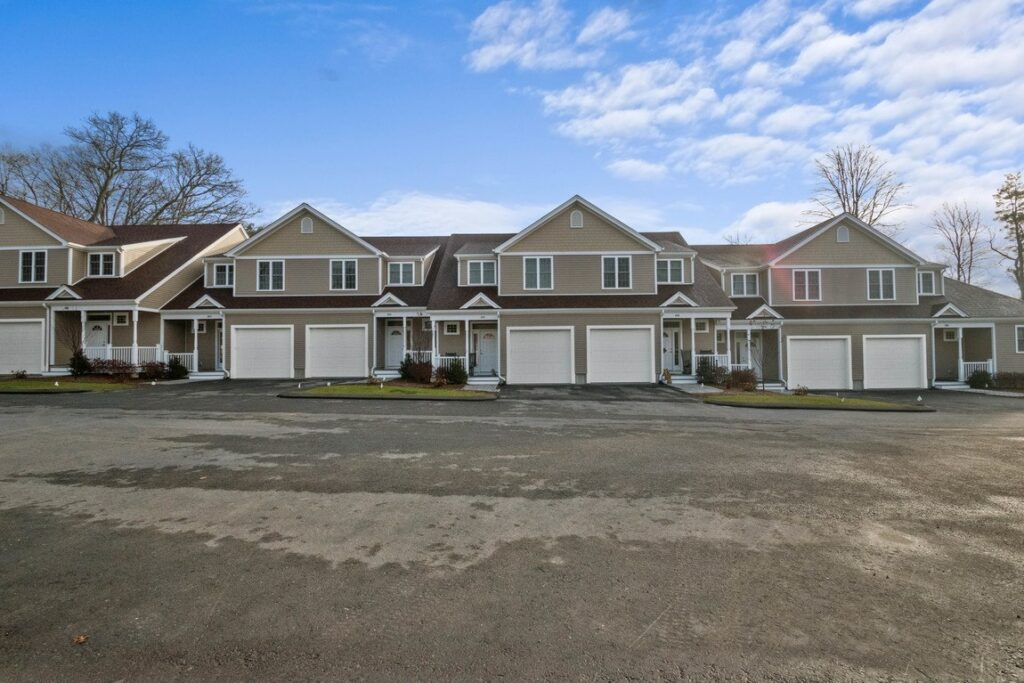 Front exterior photograph of condominiums at Endicott Woods in Norwood, MA