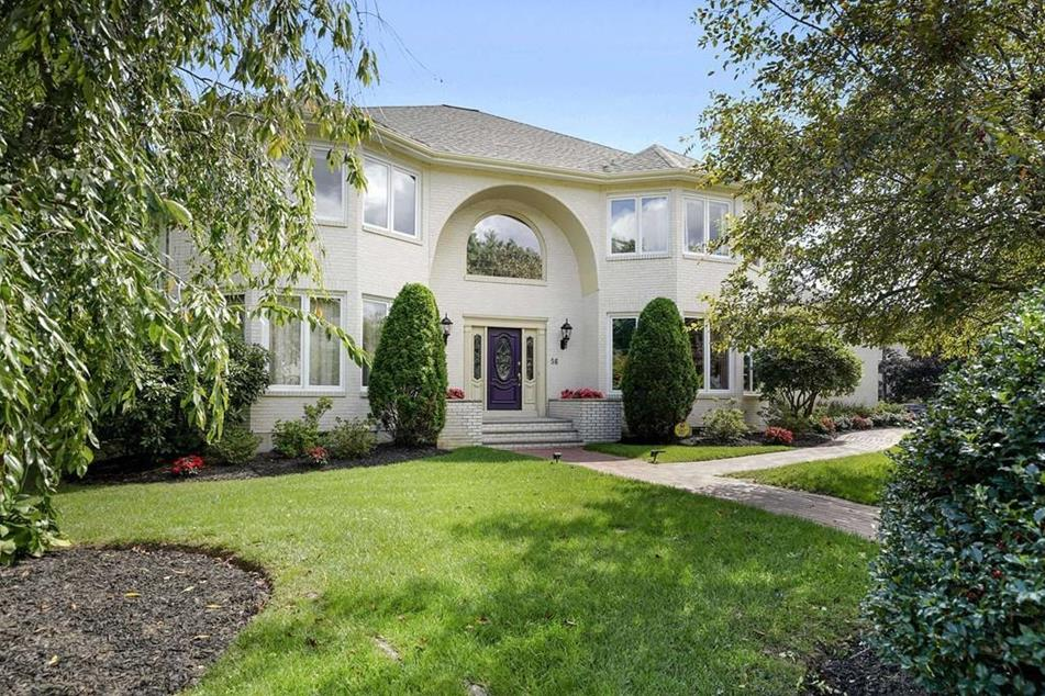 Front exterior photograph of 56 Forbes Road in Westwood MA