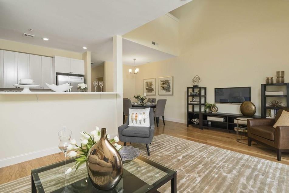 Living room photograph of Endicott Woods Unit #1205